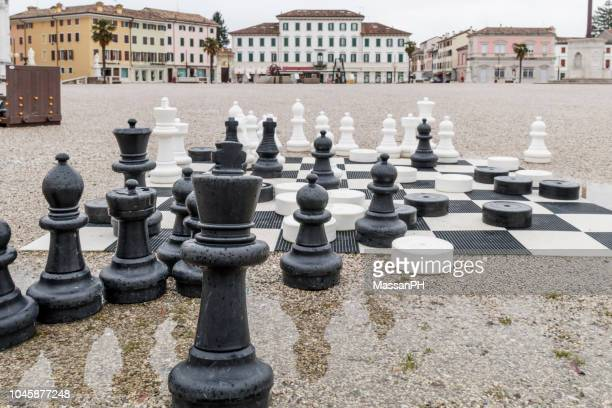 big chess on the square of palmanova - giantess stock photos and pictures