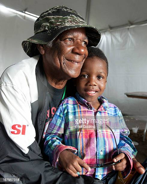 Big Chief Monk Boudreaux of the Golden Eagles Mardi Gras Indians watches Fi Yi Yi the Mandingo Warriors with his grandson Nquan during the 2013 New...