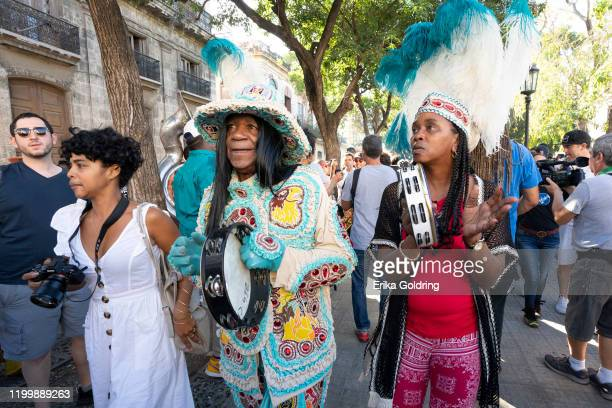 Big Chief Monk Boudreux and Chellene Bailey of the Golden Eagles Mardi Gras Indias participate in a New Orleans second line conga in Old Havana on...