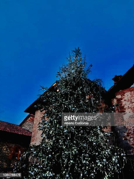 big christmas tree with lights in ricetto of candelo, biella province, piedmont, italy - ビエラ ストックフォトと画像