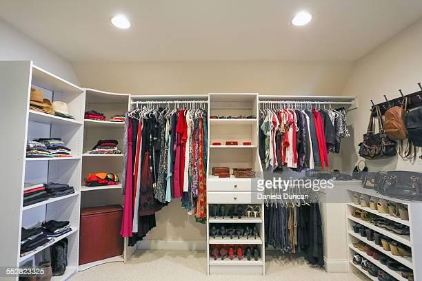 big closet - walk in closet stock photos and pictures