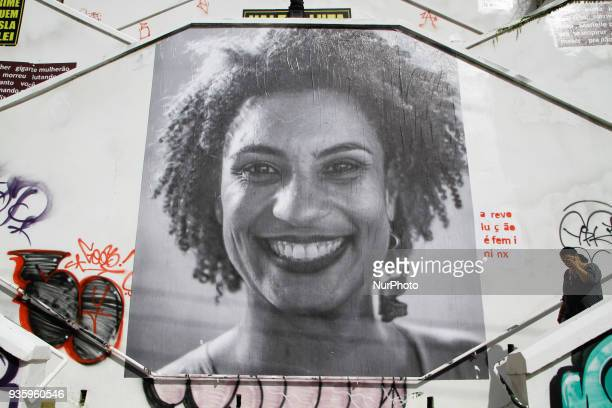 A big collage with photo of Deputy Mayor of Rio de Janeiro Marielle Franco is seen in the stairwell of Cristiano Viana Street in the neighborhood of...