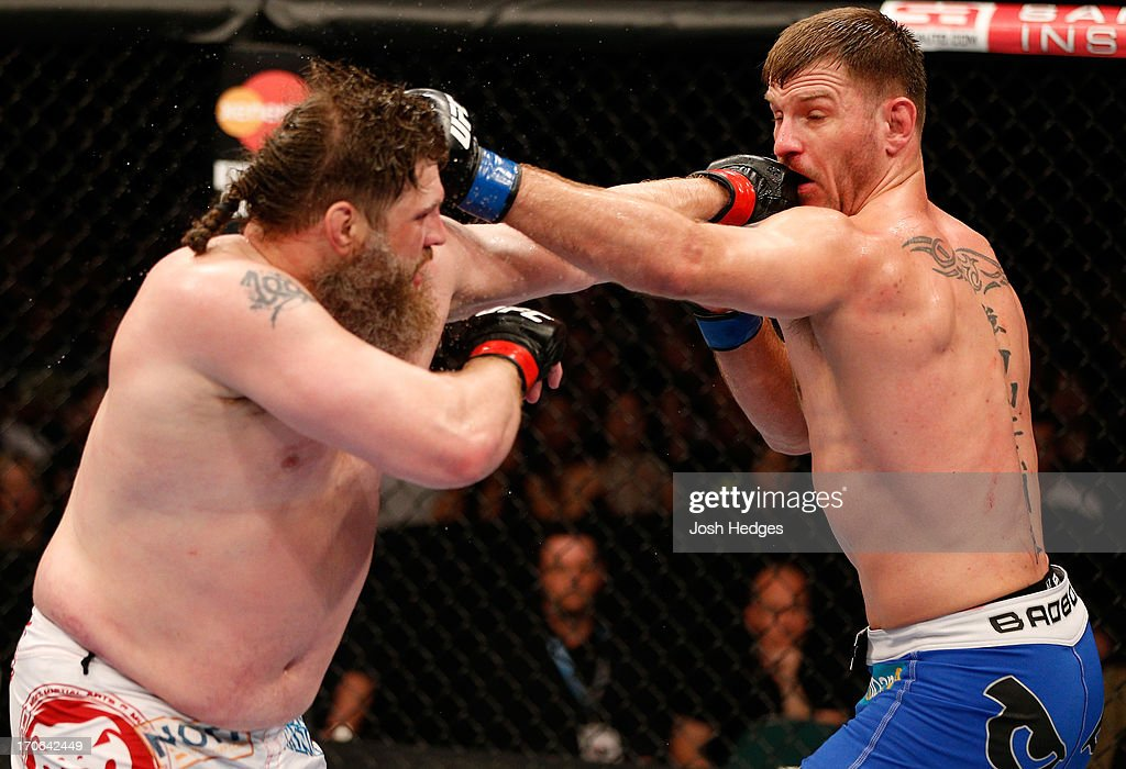 'Big Country' Roy Nelson and Stipe Miocic trade punches in their heavyweight fight during the UFC 161 event at the MTS Centre on June 15, 2013 in Winnipeg, Manitoba, Canada.