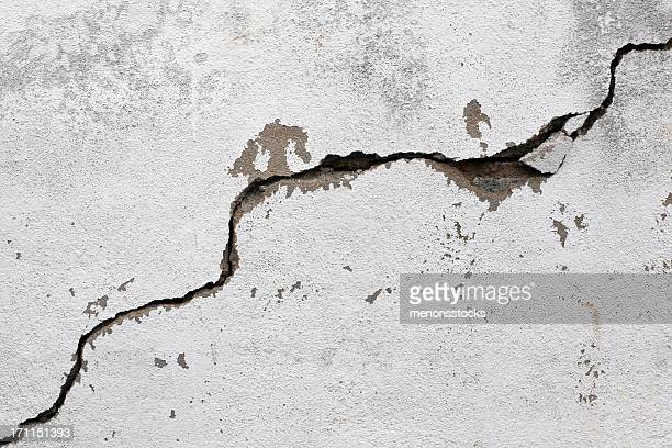 a big crack on an old, rotten wall - earthquake stock pictures, royalty-free photos & images
