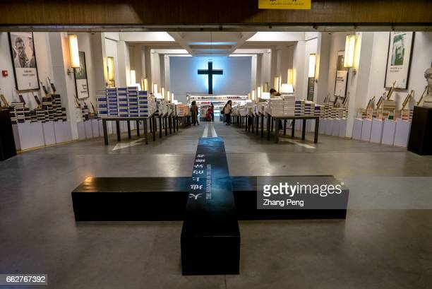Big cross in the bookstore as a spiritual icon Renovated from an old underground parking lot with the decorative style of Church Librairie AvantGarde...