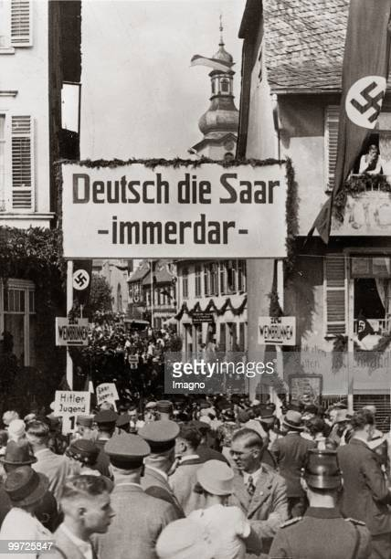 Big crowd is demonstrating in Ruedesheim for the return of the Saarland to Germany. Germany. Photograph. Before 1935.