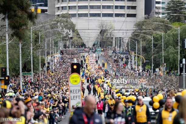 Big crowd looks on during the 2019 AFL Grand Final Parade on September 27, 2019 in Melbourne, Australia.