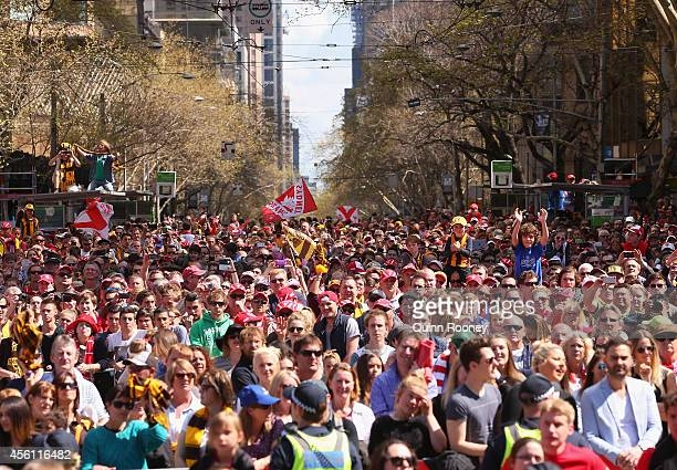A big crowd watches on during the 2014 AFL Grand Final Parade on September 26 2014 in Melbourne Australia