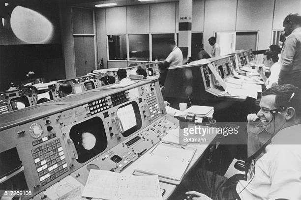 Big Day at Space Center Space Center Houston Flight Director Glynn Lunney sits at his console in Mission Control Center with his face wreathed in a...