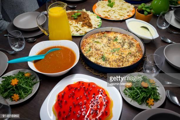 big dinner with a lot of food - iftar stock-fotos und bilder