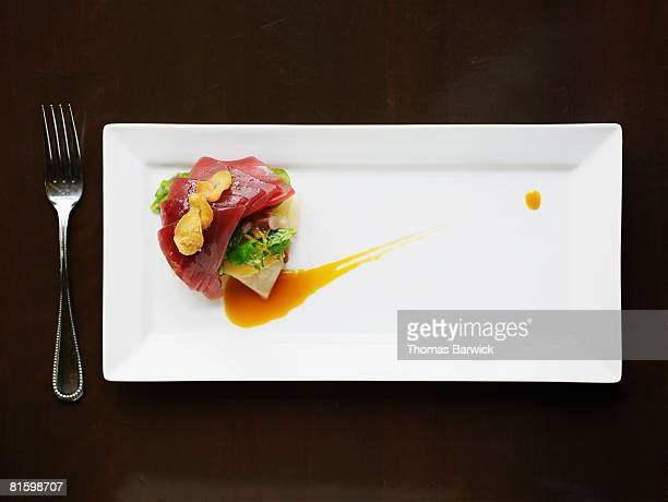 big eye tuna tartare with crenshaw melon, brioche, orange reduction, mache and garlic chips - rectangle stock pictures, royalty-free photos & images