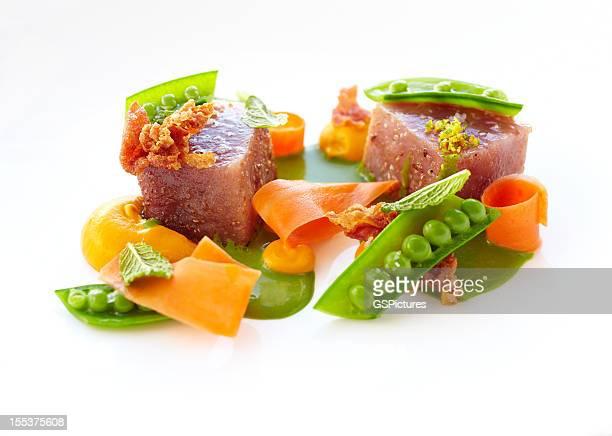 Big eye tuna with pea shoots and crispy prosciutto