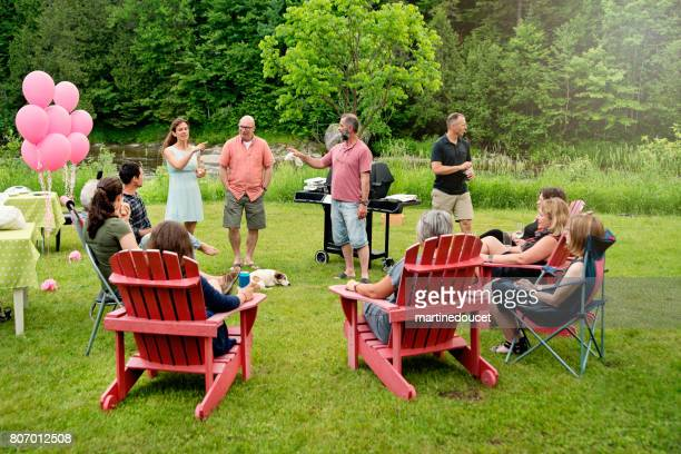 Big family at happy hour before BBQ, summer outdoors.