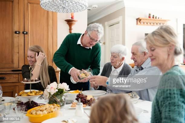 Big family dinner including mult-generation family like senior and millennial family.