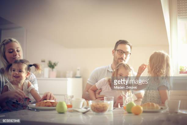 Big family having breakfast together.