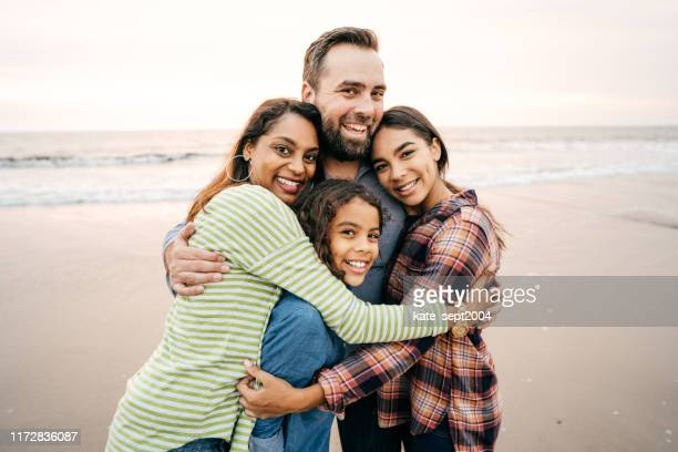 big family hug - four people stock pictures, royalty-free photos & images
