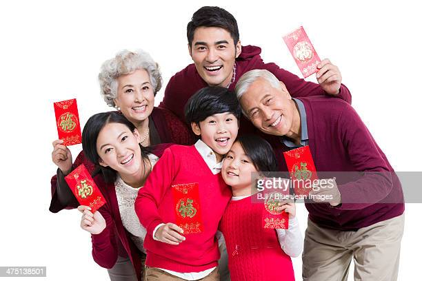 Big family with red pockets in Chinese New Year