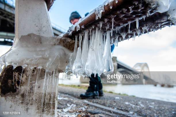 Big formations of ice below a bench, as a consequence of the low temperatures in Nijmegen, The Netherlands, on February 12th, 2021.