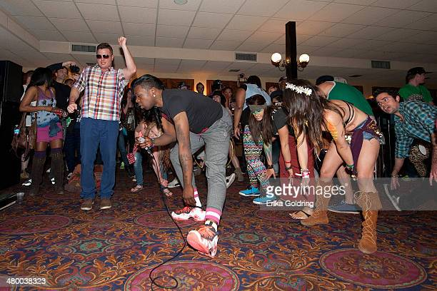 Big Freedia gives a twerk lesson on the SS BluKu riverboat during the 2014 BUKU Music Art Project at Mardi Gras World on March 21 2014 in New Orleans...