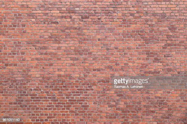 big full frame background of detailed old red brick wall with copy space - muur stockfoto's en -beelden