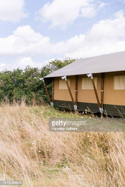 big glamping tent in nature camping site - kamperen stock pictures, royalty-free photos & images