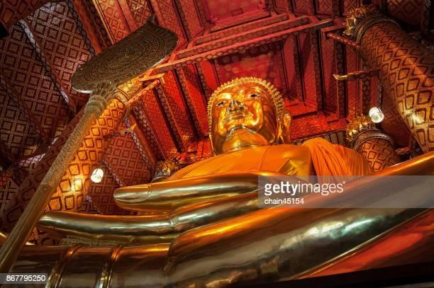 Big golden buddha statue in temple at Ayuthaya Thailand.