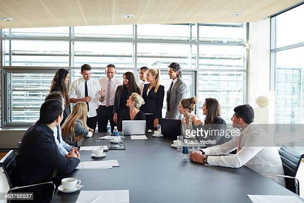Big group of business people having discussion