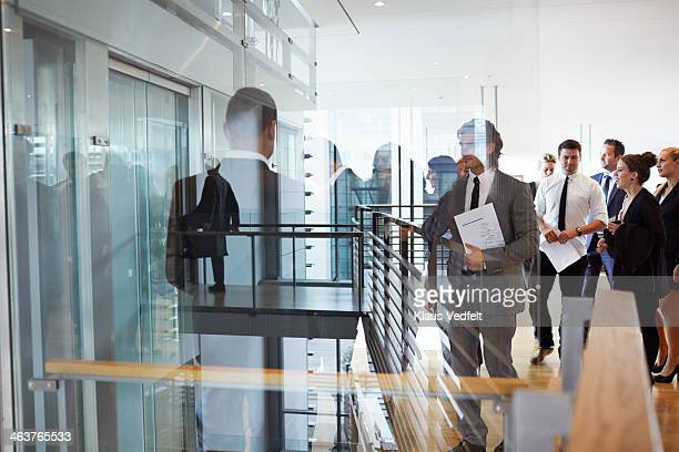 Big group of business people waiting at elevator