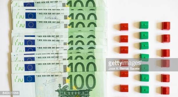 Big group of tickets of hundred Euros and several marries of toy on a white bottom