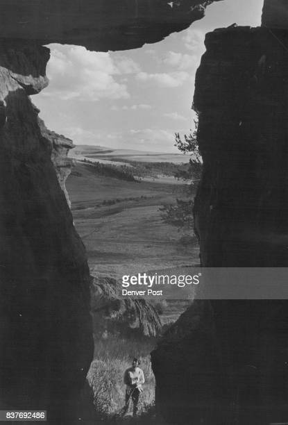 Big Horn Mountain Frame An enormous rock overhang and the cave behind it frame Mickey Hall of Cheyenne Wyo on the eastern slope of Wyoming's Big Horn...