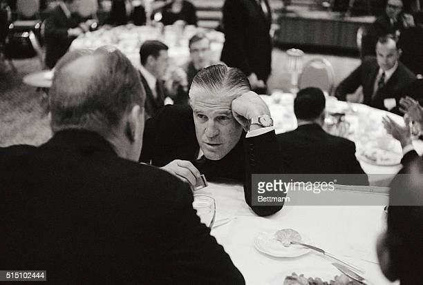 Big Huddle Washington DC Michigan Governor George Romney leans on elbow as he confers with House GOP leader Gerald R Ford at the National Governors'...