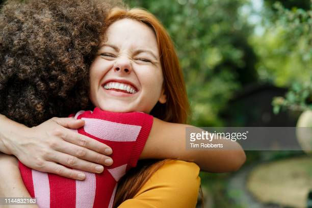 big hug! - friendship stock pictures, royalty-free photos & images