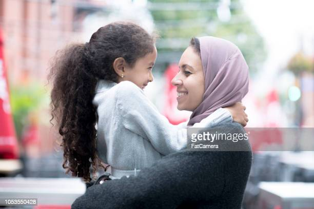 big hugs between mother and daughter - family politics stock pictures, royalty-free photos & images