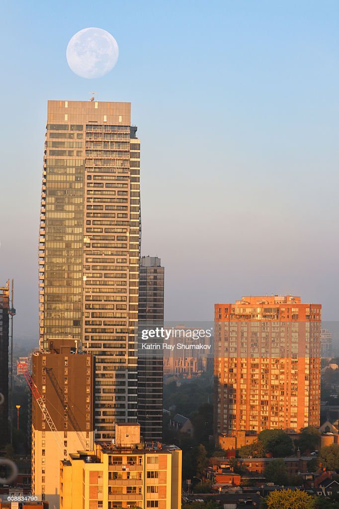 Big 'i' Statement of Harvest Moon on Morning Cityscapes : Stock Photo