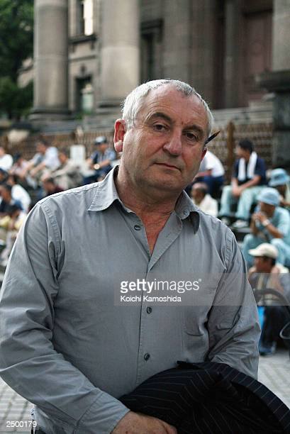 Big Issue founder John Bird poses in front of a church where many homeless people gather on September 16 2003 in Osaka Japan Bird has chosen Japan's...
