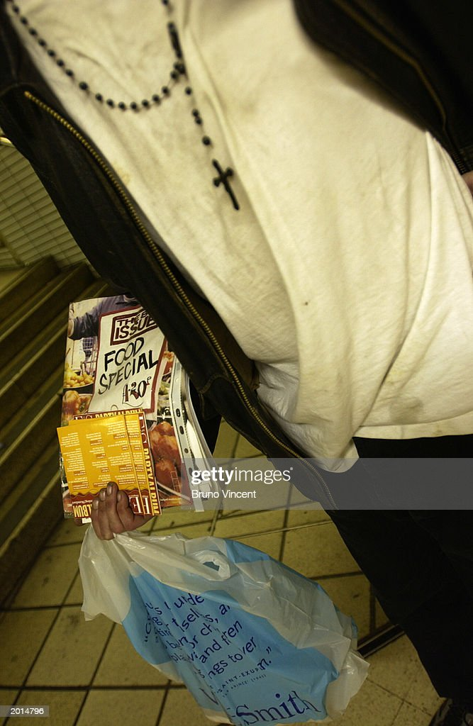 Big Issue seller Luke Davany, who is often helped out by Crisis Urban Village project, trys to sell his last copy May 20, 2003 at Kings Cross station in London, United Kingdom. Big Issue is a magazine sold on the street and the proceeds benefit the homeless. Pink Floyd guitarist David Gilmour has donated 3.6 million pounds from the sale of his house to the Crisis Urban Village project, a group that provides homes for the homeless and low income workers.