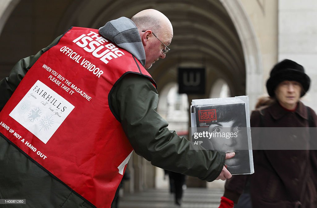 Big Issue seller Steven jokes as he sells the magazine in the street near Charing Cross in central London on February 14, 2012.