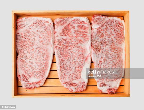 Big japanese wagyu beef like marble on wooden tray on white background