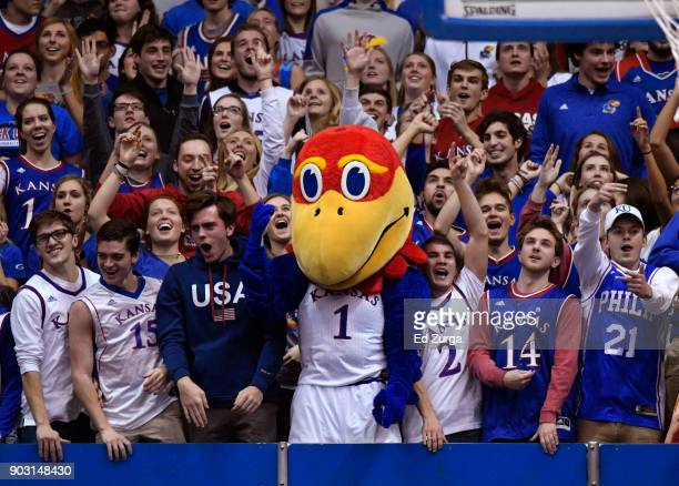 Big Jay the Kansas Jayhawks mascot hangs with students as they cheer for the Kansas Jayhawks during a game against the Iowa State Cyclones in the...