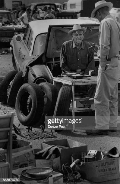 SEP 21 1969 SEP 23 1969 SEP 24 1969 'Big Jim' Applequist of Golden relaxes in the trunk of his car as he talks to a potential customer about the used...