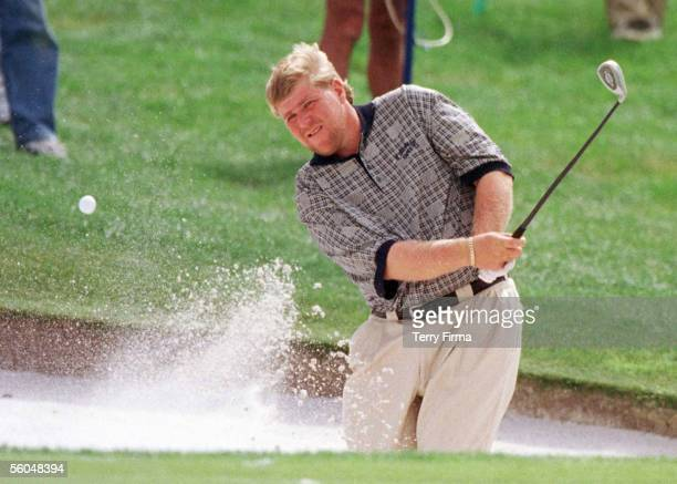 Big John Daly chips out of thee bunker on the 6th on day two of the World Cup Of Golf played at the Gulf Harbour Country Club Whangaparoa