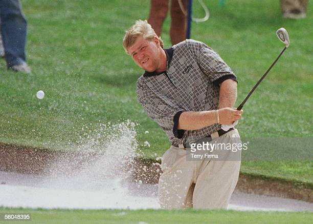 Big John Daly chips out of thee bunker on the 6th on day two of the World Cup Of Golf played at the Gulf Harbour Country Club Whangaparaoa