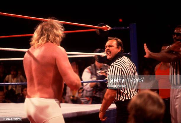 Big John Studd and Referree Dick Butkus at Wrestlemania 2 at the Rosemont Horizon in Rosemont, Illinois April 7,1986.