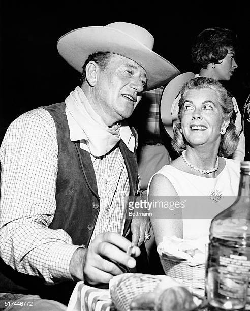 HOLLYWOOD WESTERN PARTY Big John Wayne fully approved of the cowboy theme for the gigantic SHARE charity party He exchanges gossip with Mrs Gary...