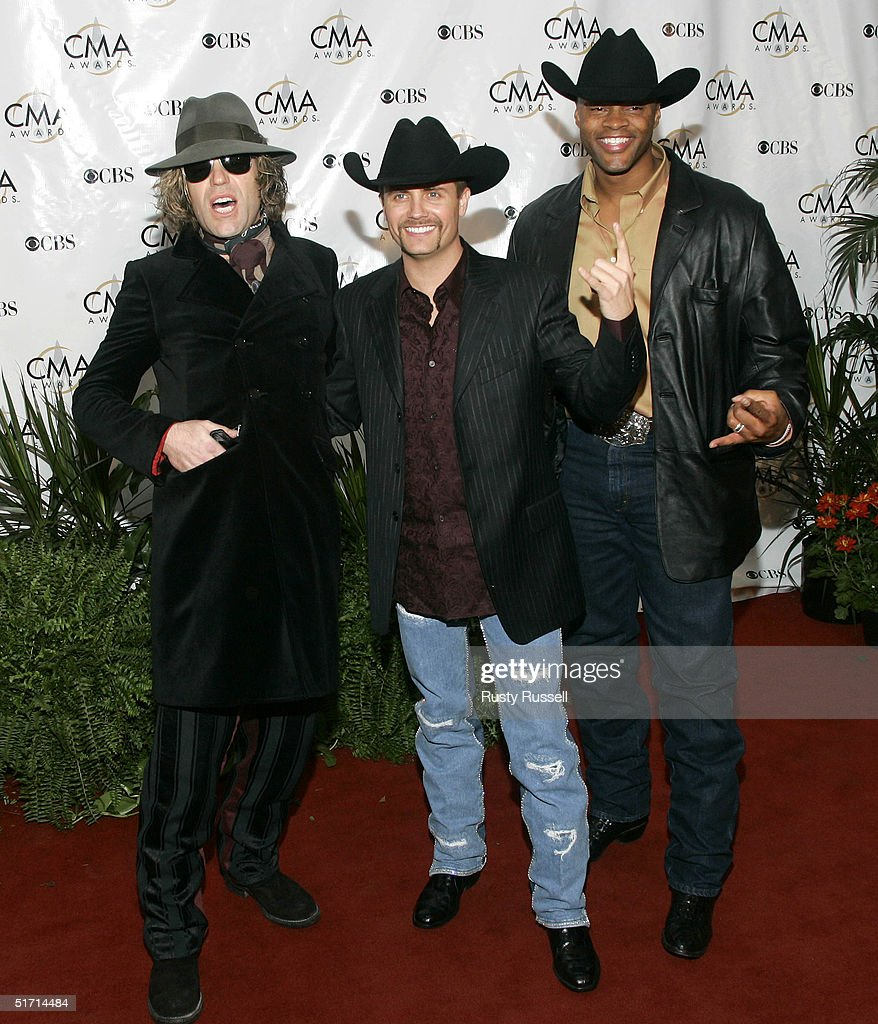 Big Kenny Alphin, John Rich and Cowboy Troy of Big and Rich arrive at the 38th Annual CMA Awards at the Grand Ole Opry House November 9, 2004 in Nashville, Tennessee.
