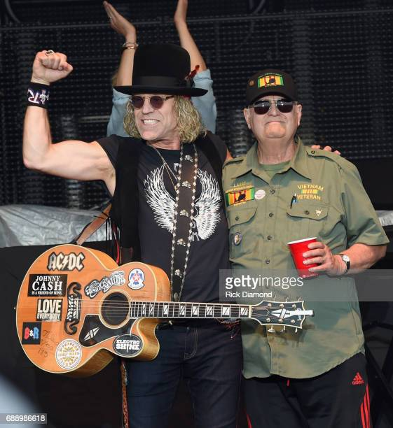 Big Kenny and John Rich of Big and Rich honor Viet Nam War Veteran Larry Paul by performing 8th of November during Tree Town Music Festival Day 2 on...