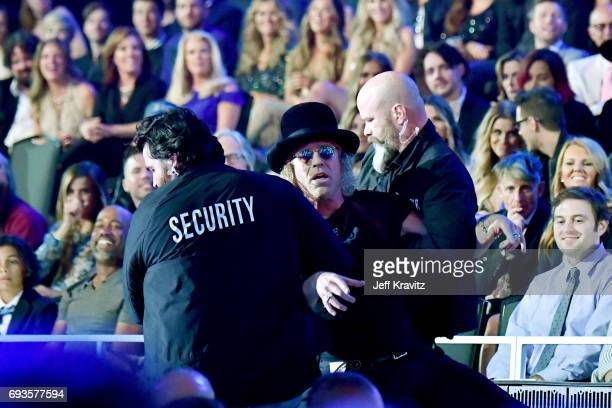 Big Kenny of Big Rich carried off stage durring the 2017 CMT Music Awards at the Music City Center on June 7 2017 in Nashville Tennessee
