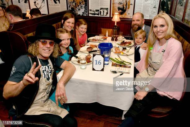 Big Kenny of musical duo Big & Rich, Make-A-Wish family and US Olympian Lindsey Vonn take photos with the family during Waiting for Wishes Celebrity...
