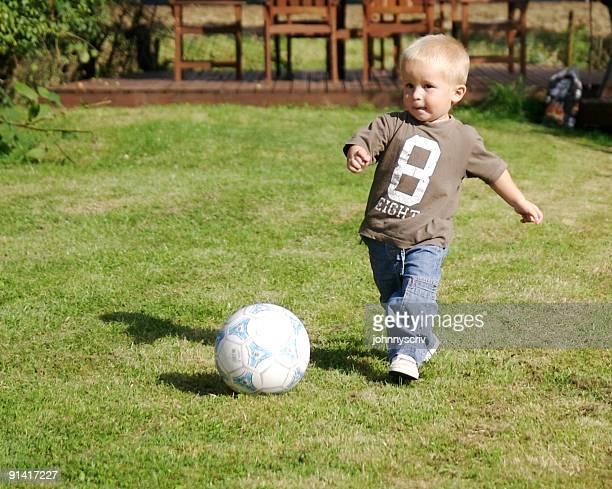 big kick... - kicking stock pictures, royalty-free photos & images