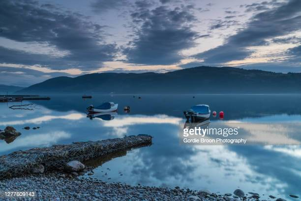 big loch reflections. - loch ness stock pictures, royalty-free photos & images